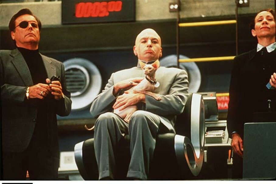 Mike Myers (center) spoofed the typical longwinded villain when he played Dr. Evil in 1997's 'Austin Powers: International Man of Mystery.' Hulton Archive/Getty Images