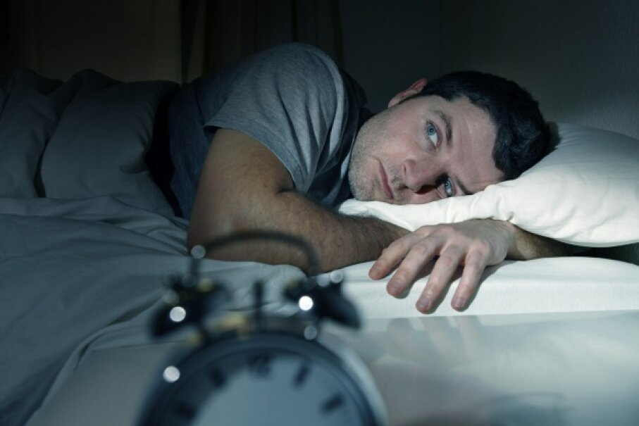 Man experiencing trouble falling asleep