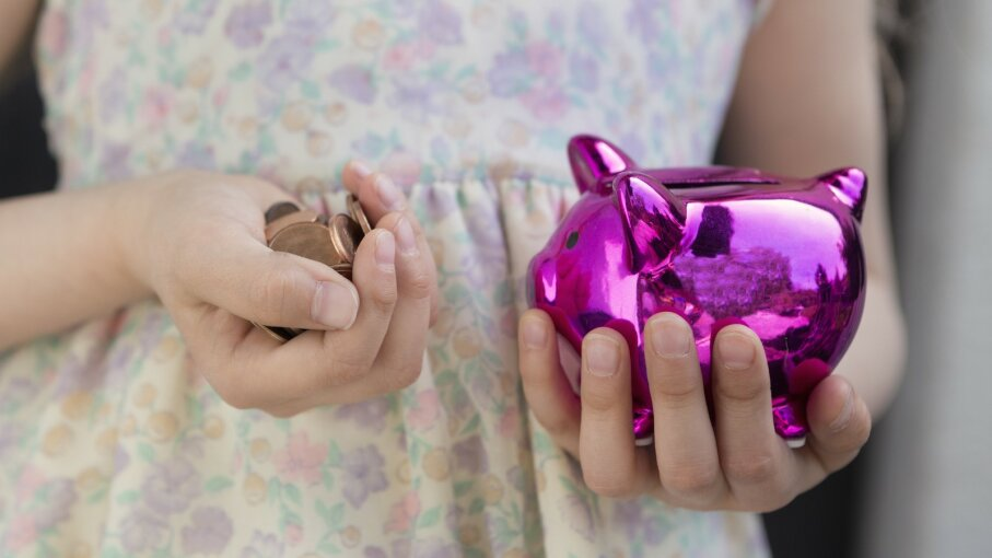 Girl with a pink piggy bank