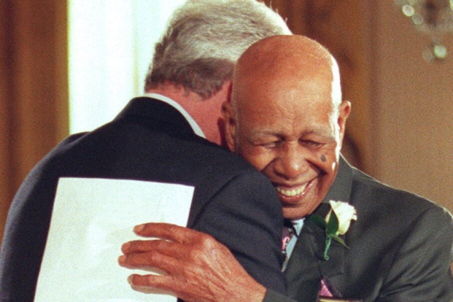 In 1997, a formal public apology was issued to victims of the Tuskegee Syphilis Study. Here, Herman Shaw embraces President Bill Clinton during the apology ceremony.  © STEPHEN JAFFE/AFP/Getty Images