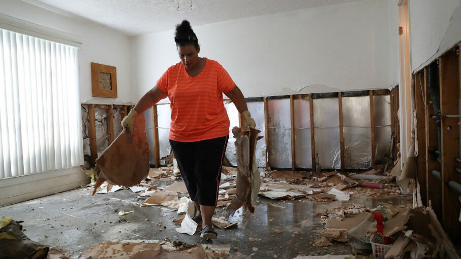 Regina Perry carries wet sheetrock as she cleans out of her home that was inundated with water as she begins the process of rebuilding after Hurricane Harvey caused widespread flooding in Houston. Joe Raedle/Getty Images