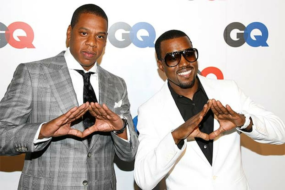 Rappers Jay-Z and  Kanye West make the 'pyramid sign' at a GQ anniversary party. Is that signal a nod to  the Illuminati? © Leon/Retna Ltd./Corbis