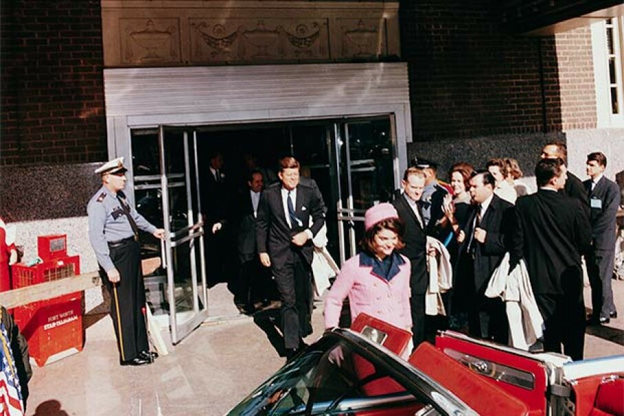 President John F. Kennedy and First Lady Jacqueline Kennedy emerge from a Fort Worth, Texas theater into a waiting car  on the day of his assassination. © CORBIS