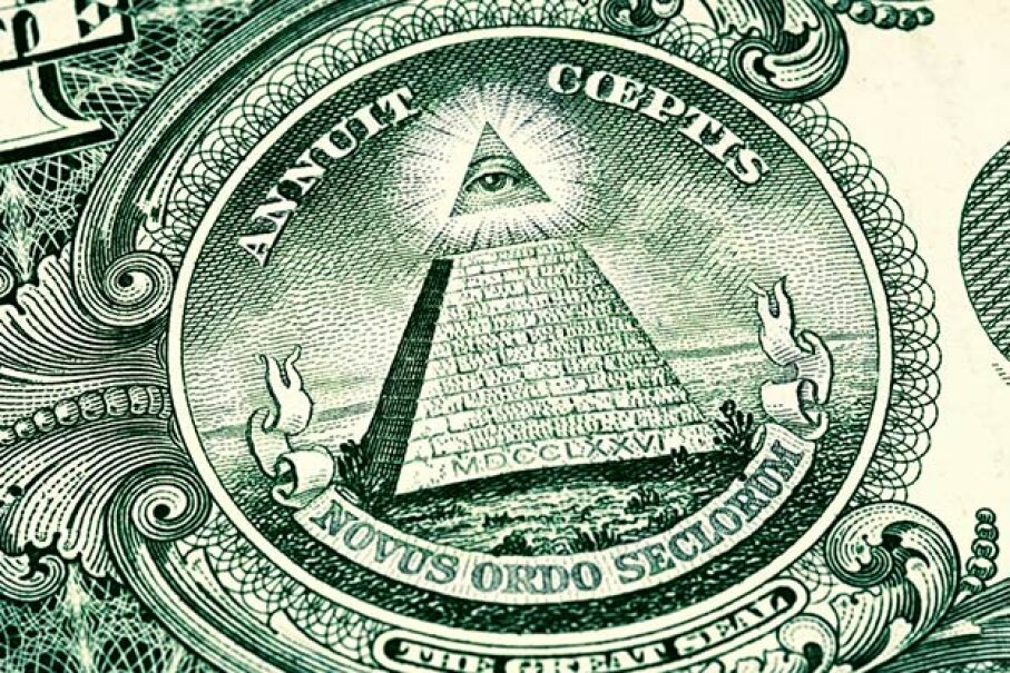 The pyramid and the 'all-seeing eye' on the back of the U.S. dollar bill are clear signs of Illuminati control, believers say. Rouzes/Getty Images