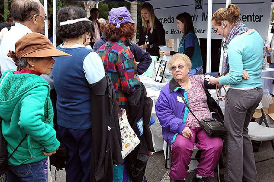 A senior citizen receives a free blood pressure check during a healthy living festival in Oakland, California. Common thinking is that most immigrants come to the U.S. for the benefits but studies show they use less of them than native-borns. Justin Sullivan/Getty Images