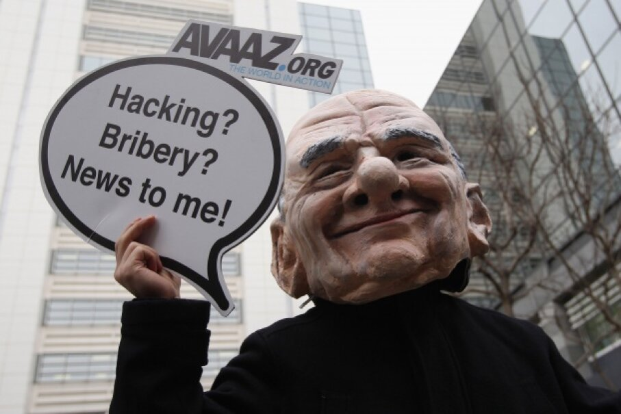 A protestor dressed as Rupert Murdoch during a February 2012 protest in London, England.  ©Dan Kitwood/Getty Images