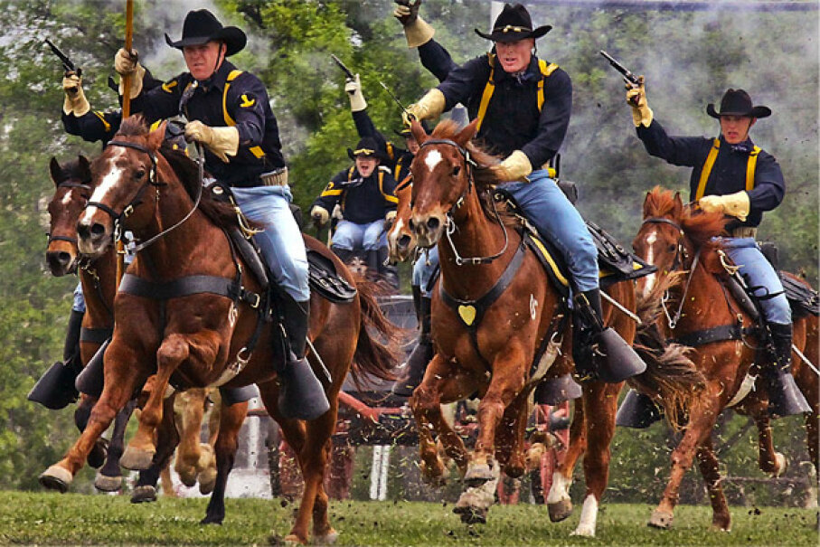 Gunpowder and dirt hang in the air as the U.S. Army's 1st Cavalry Division horse detachment make their traditional 'cavalry charge' to conclude a March 25, 2009, ceremony at Fort Hood, Texas. Image courtesy U.S. Army (CC By 2.0 license)