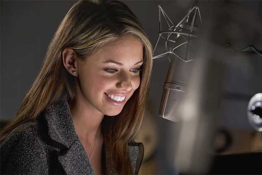OK, this voice-over artist is not in her pajamas -- but she could do her job that way! Jupiterimages/Stockbyte/Thinkstock