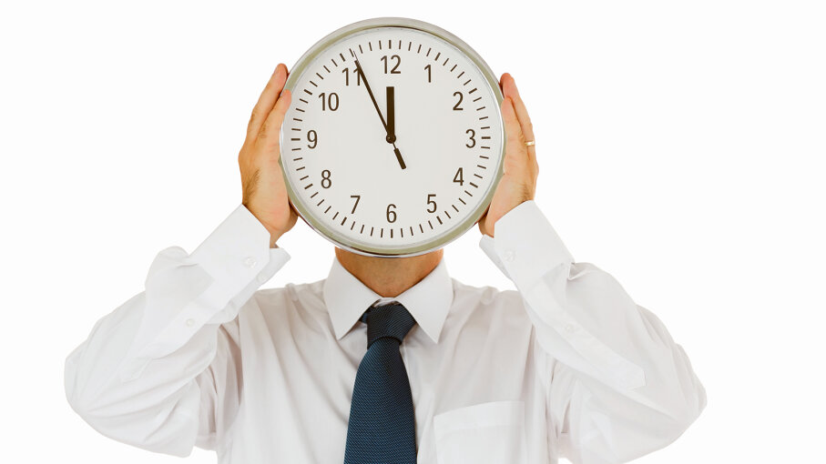 man with clock over face