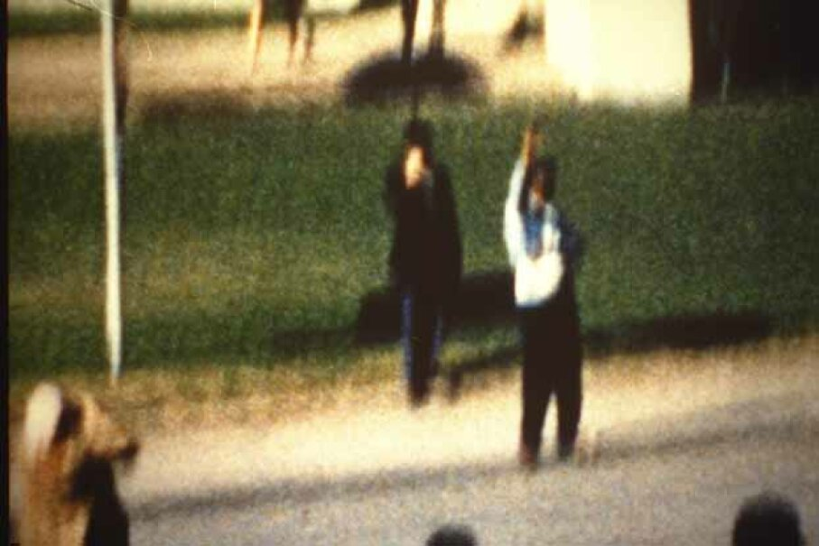 "The film ""JFK"" posited that the men with the umbrella and the radio are giving the signal to Kennedy's shooter(s).  In 1978, a man came forward claiming to be ""Umbrella Man"" and said he only used the umbrella to heckle Kennedy. Pascal Le Segretain/Sygma/Corbis"