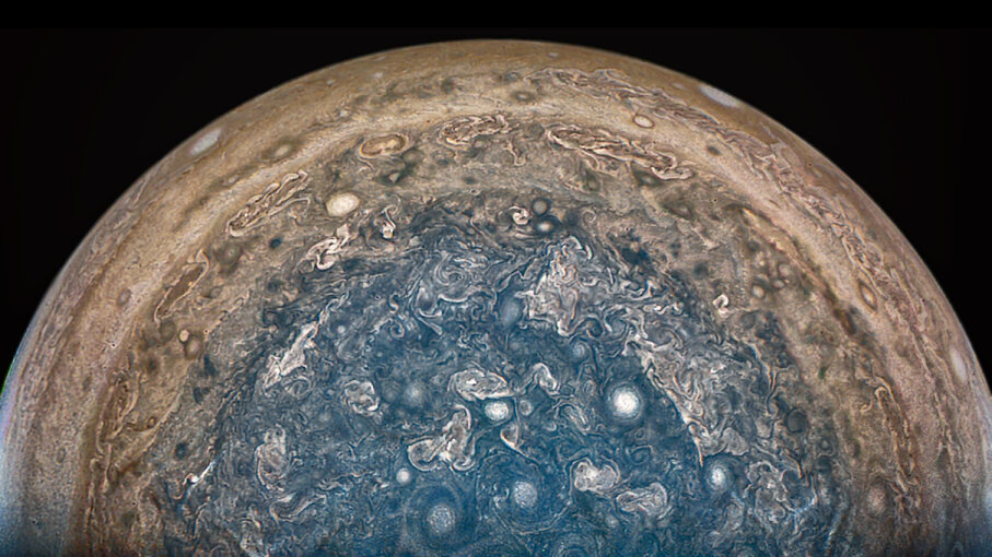 "The Juno spacecraft has spent time at Jupiter's south pole, sending images back from ""beneath"" the planet. NASA/JPL-Caltech/SwRI/MSSS/Betsy Asher Hall/Gervasio Robles"