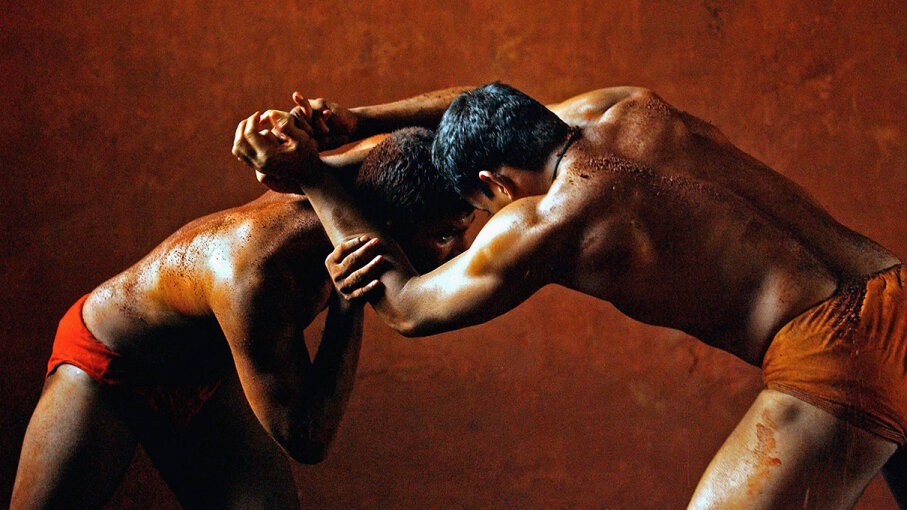 Two men practice the sport of kushti, an ancient form of wrestling in South Asia. Ami Vitale/Getty Images