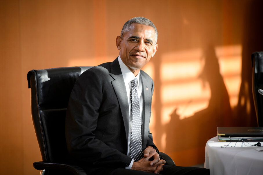 Barack Obama sitting in chair
