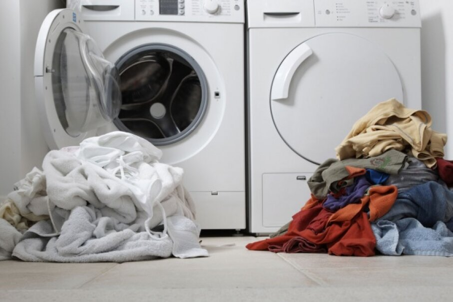 Don't take up space at the laundromat sorting your dirty clothes. Do that at home before you head out. © Martin Poole/Digital Vision/Thinkstock