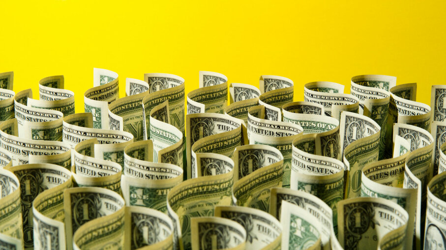 dollar bills on a yellow background