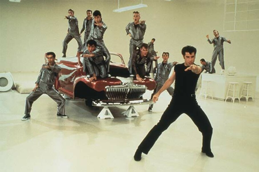 """""""Go, greased lightning!"""" John Travolta and the guys knew this just meant their car was  superfast. Paramount Pictures/Fotos International/Getty Images"""