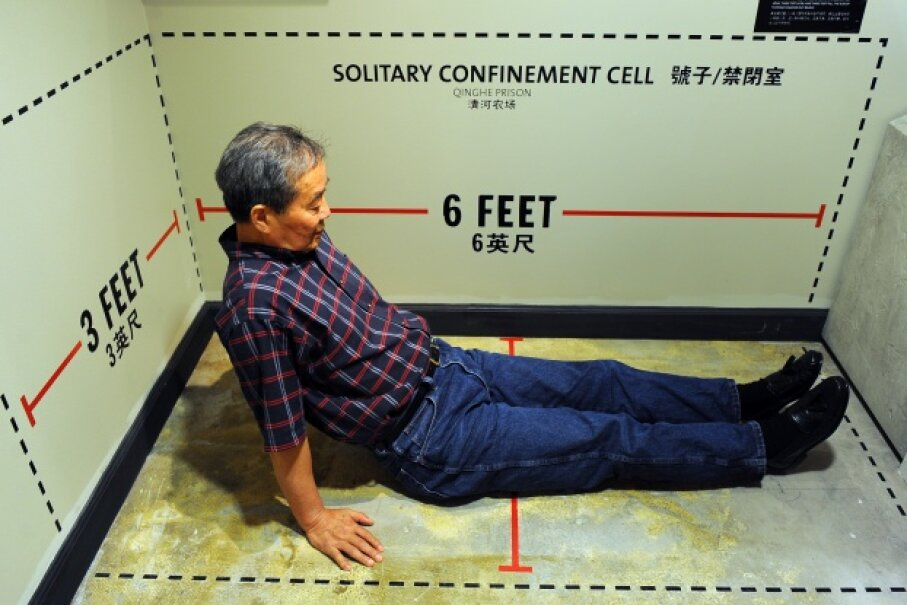 Harry Wu sits in an exhibit showing the exact dimensions of his solitary confinement cell where he spent 11 days at a labor prison camp. The exhibit was on display at the Laogai Museum on June 20, 2011, in Washington, D.C. Wu founded the U.S. museum, which is dedicated to exhibits about the forced labor prison camps and human rights abuses in China. Ricky Carioti/The Washington Post via Getty Images