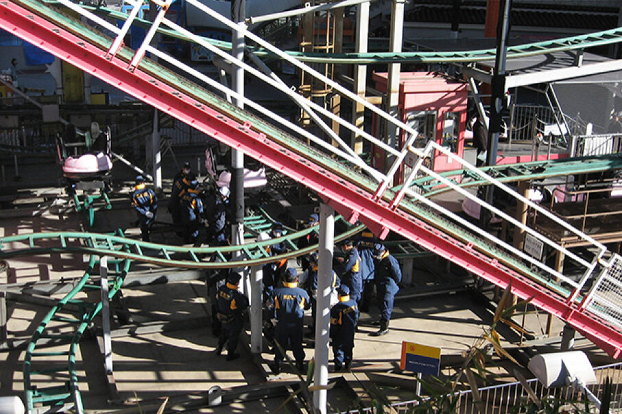 Police officers inspect a roller coaster at the Tokyo Dome City amusement park in Tokyo in 2011 one day after a man died after falling off a ride 8 meters (26 feet) above the ground. JIJI PRESS/AFP/Getty Images)