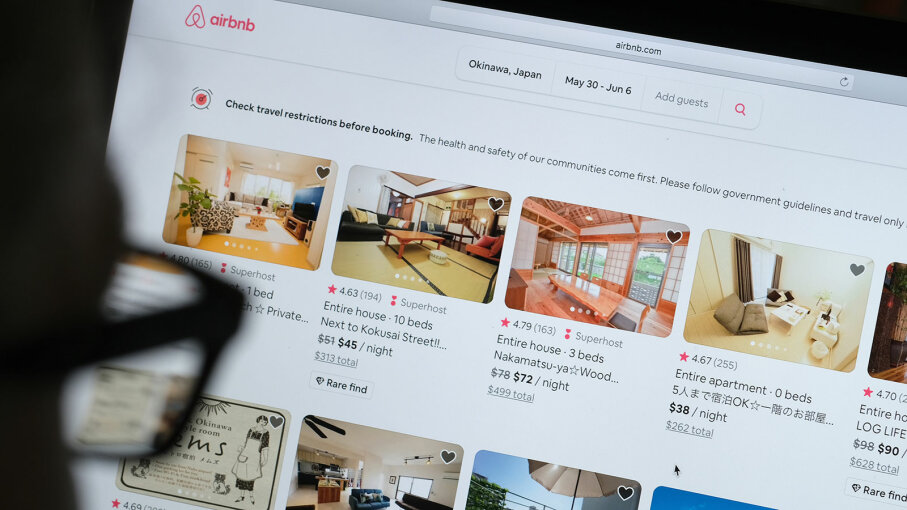 man looks at the Airbnb website