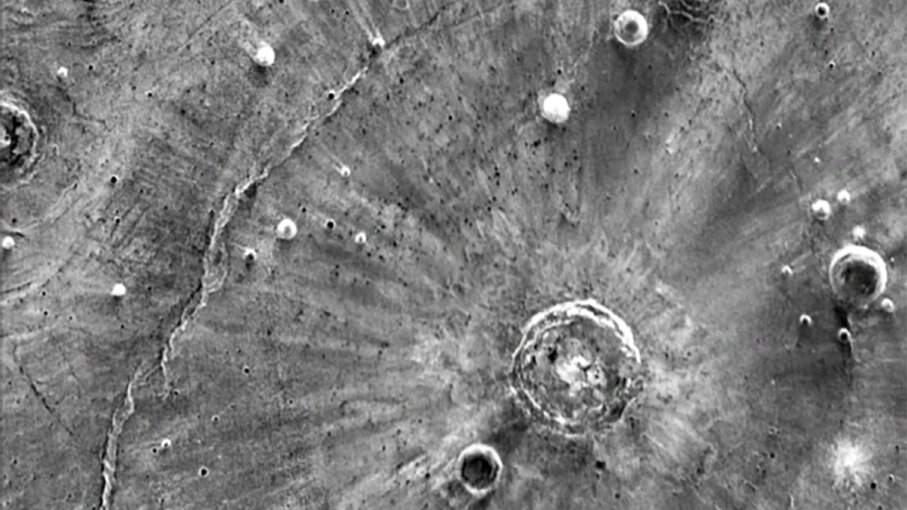 This infrared of the Santa Fe crater on Mars shows bright streaks extending from the impact site; a new study suggest the streaks were caused by tornado-force winds created by the impact that formed the crater. NASA/JPL-Caltech/Arizona State University