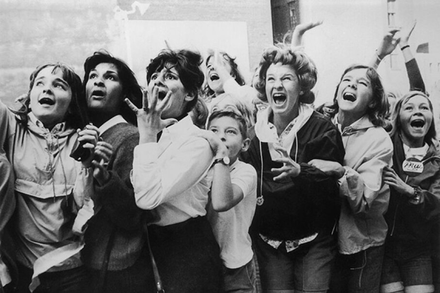 Teenage girls and women scream during a Beatles visit to Toronto in the 1960s.  Mass hysteria comes in many forms. Fox Photos/Getty Images