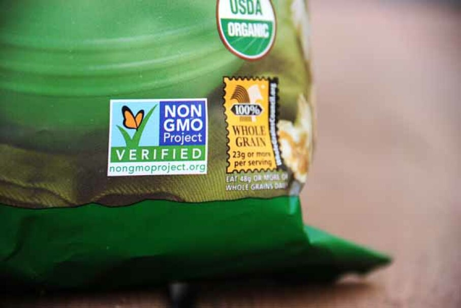 A label on this bag of popcorn indicates it is non-GMO. Some grocery chains will start labeling their products to let consumers know they do not contain GMOs. A referendum to make this the law in California was defeated in 2012. ROBYN BECK/AFP/Getty Images