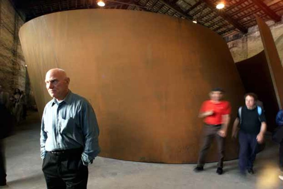 Richard Serra is known for his massive sculptures. Here, he poses in front of one in the pavillon of the 49th International Art Exhibition in Venice in 2001. © Reuters/CORBIS