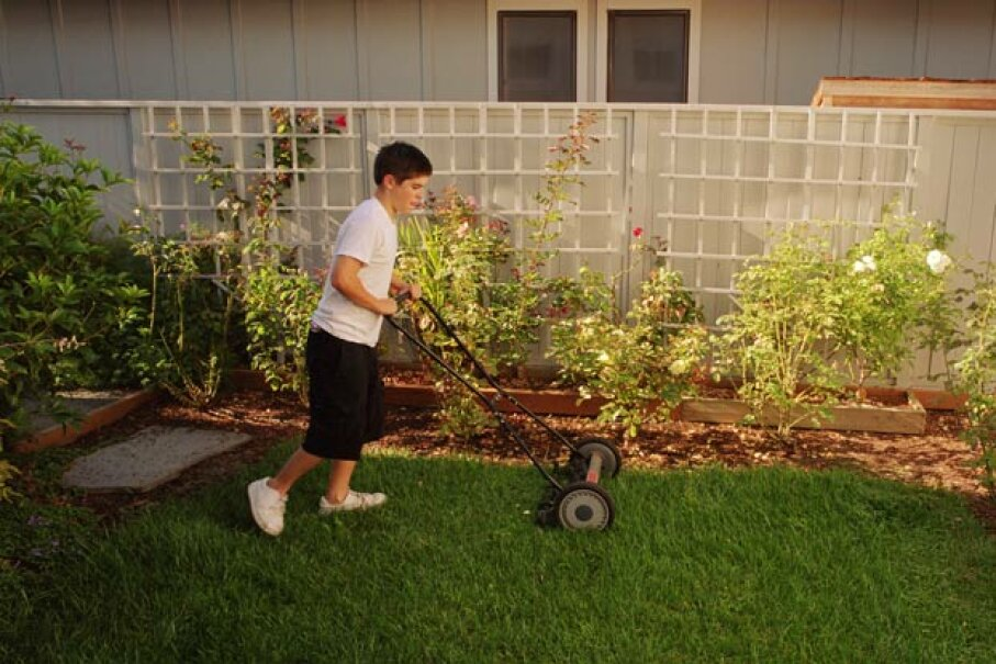 Your neighbors will often be looking for someone to cut their grass. Jupiterimages/Brand X Pictures/Thinkstock