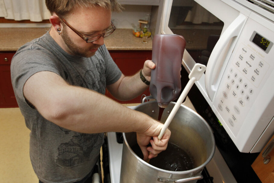 Ryan Beck of Minneapolis has been brewing beer in his home for about seven years and now has it down to a science. © Tom Wallace/ZUMA Press/Corbis