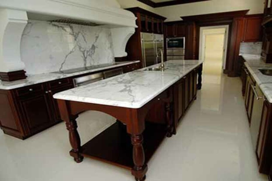 The kitchen at Donald Trump's Maison l'Amitie house in Palm Beach, Fla. There's a gargantuan fountain in the driveway out front and 475 feet of oceanfront out back. AP Photo/Steve Mitchell