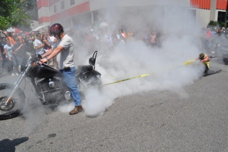 Juli Moody restrains a motorcycle at Ray Price Harley-Davidson in Raleigh, North Carolina. PRWeb
