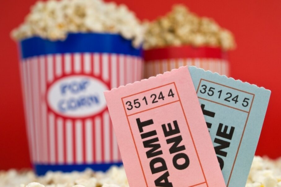 Some tickets may automatically include your snacks and other goodies like posters and access to digital content. © Antonprado/iStockphoto