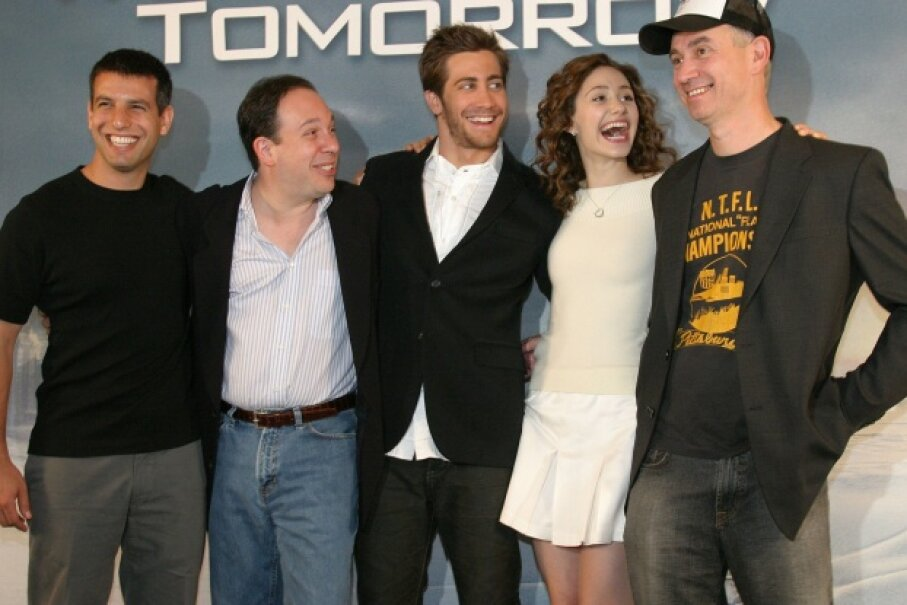 "Cast and crew of ""The Day After Tomorrow"" are all smiles at a press event; they're not worried about the science. © Dagmar Scherf/Getty Images"