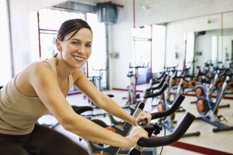 Cardio is great, but if your goal is fat loss, you should incorporate strength training as well. © Jupiterimages/Stockbyte/Thinkstock