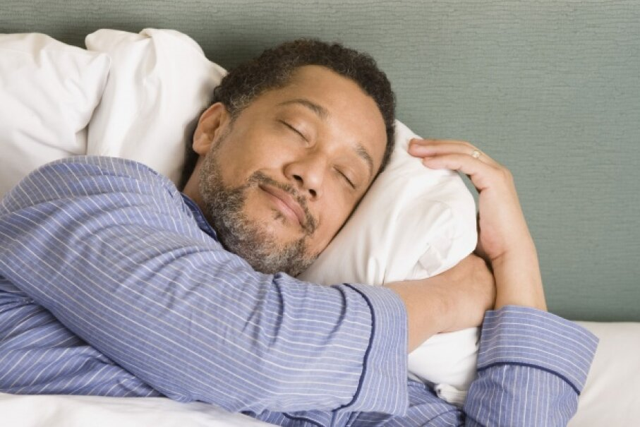 Sleeping late on your day off may feel amazing, but if you're chronically cutting your sleep short, it won't make up for the lost dozing. ©Thinkstock Images