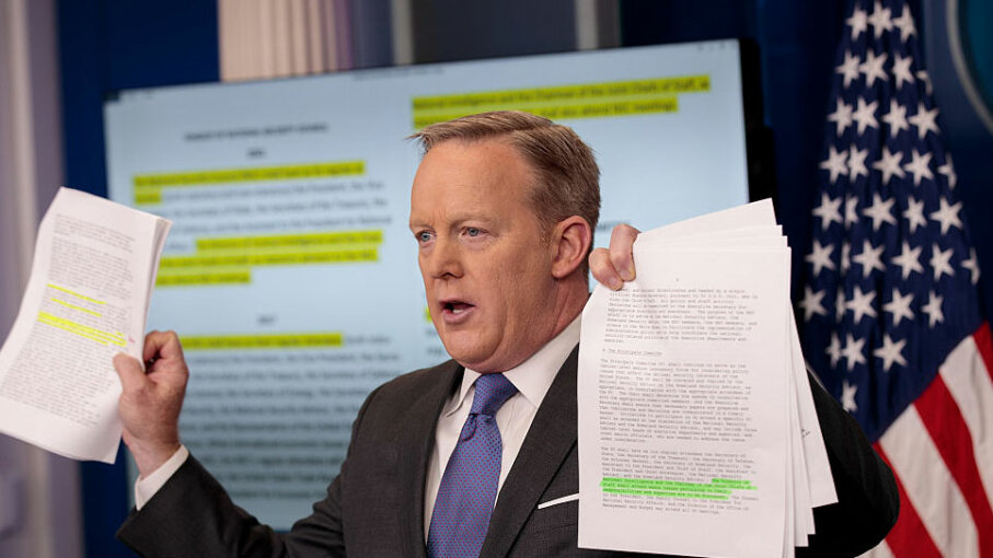 White House Press Secretary Sean Spicer holds up paperwork highlighting and comparing language about the NSC from the Trump administration and previous administrations during the daily press briefing, Jan. 30, 2017, in Washington, D.C. Drew Angerer/Getty Images