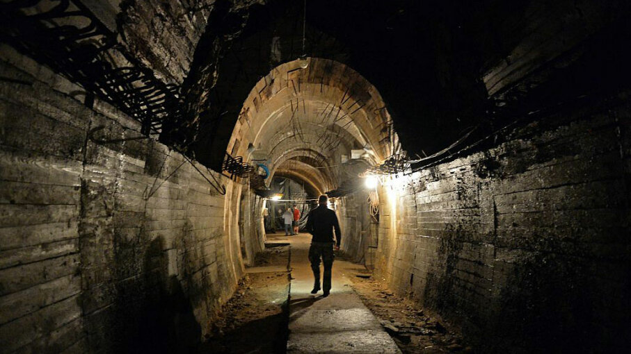 Men walk in underground galleries under the Ksiaz castle, Poland, in the area where the 'Nazi Gold Train' is supposedly hidden underground, on Aug. 28, 2015. JANEK SKARZYNSKI/AFP/Getty Images