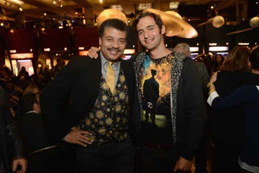 Wearing one of his signature astronomy-themed vests, Neil deGrasse Tyson (with filmmaker Jason Silva) attends the premiere of 'Cosmos: A SpaceTime Odyssey' at The Greek Theatre on March 4, 2014 in Los Angeles. Jason Kempin/Getty Images