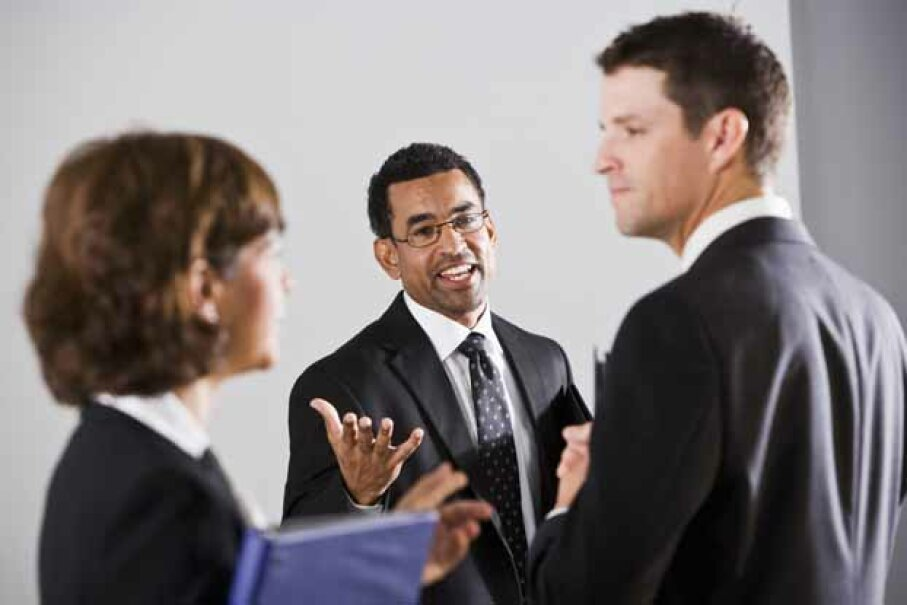 Arriving early can give you a chance to network with other professionals in a less-competitive environment. iStockphoto/Thinkstock
