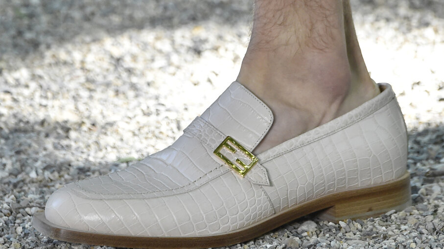 white loafer without socks
