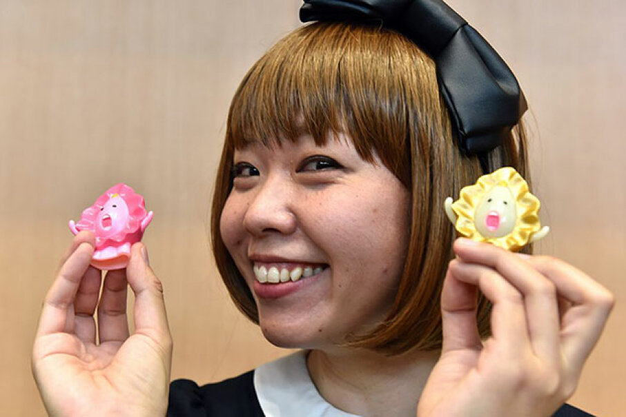 Japanese artist Megumi Igarashi shows small mascots shaped to represent vaginas, at a press conference after her first trial hearing in Tokyo. Igarashi  was arrested on obscenity charges for distributing 3D scans of her own genitals. YOSHIKAZU TSUNO/AFP/Getty Images
