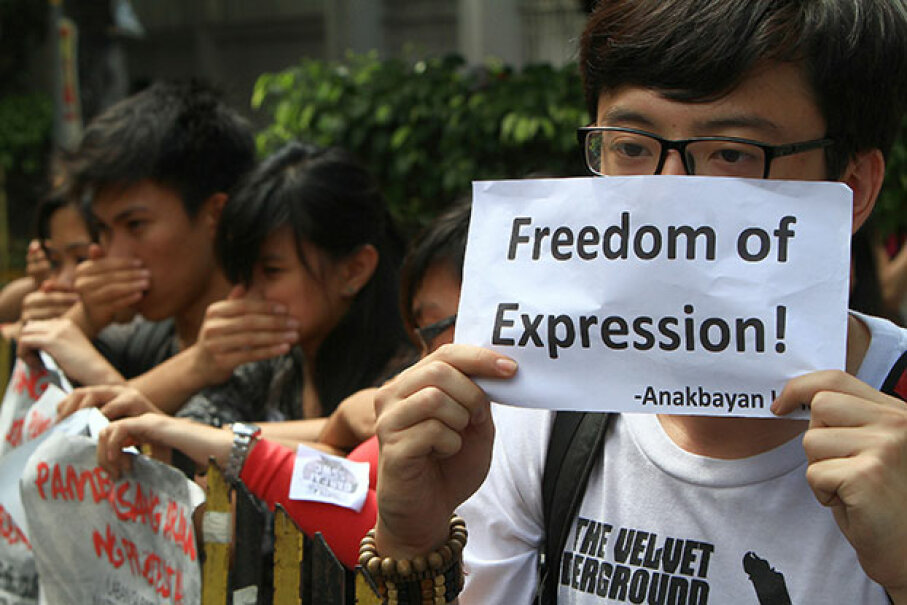 Students cover their mouths during an anti-Cybercrime Law protest in front of the Philippine Supreme Court in Manila. The Court declared constitutional several provisions in the Cybercrime Law including the one that penalizes online libel. © Rouelle Umali/Xinhua Press/Corbis