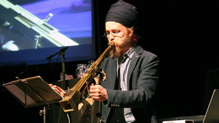 Subhraag Singh won first prize ith his futuristic, saxophone-like invention, the Infinitone. Georgia Tech