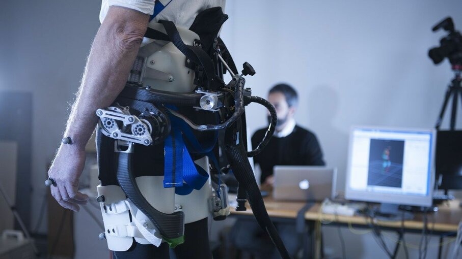 "A prototype of the exoskeleton at the Rehabilitation Center ""Fondazione Don Carlo Gnocchi"" in Florence, Italy. Those gray bumps on the hands and wrist in the photograph are reflective markers. Theyre used when the subject is videotaped walking with ... Hillary Sanctuary/EPFL"