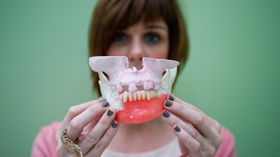 A woman displays 3-D printed teeth and jaw implants at the 2013 London 3D Printshow. Dutch scientists have developed an antimicrobial plastic.  Piero Cruciatti/Demotix/Corbis