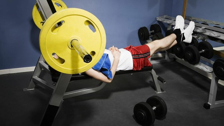 Man chilling on weight bench