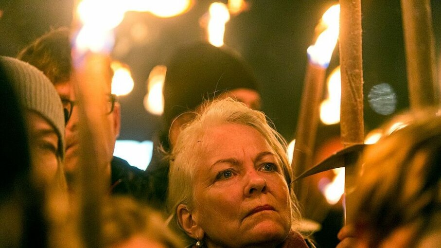 People gather at a torchlight procession in remembrance of murdered police officer Dec. 11, 2016 in Albertslund, Denmark. Ole Jensen - Corbis/Corbis via Getty Images