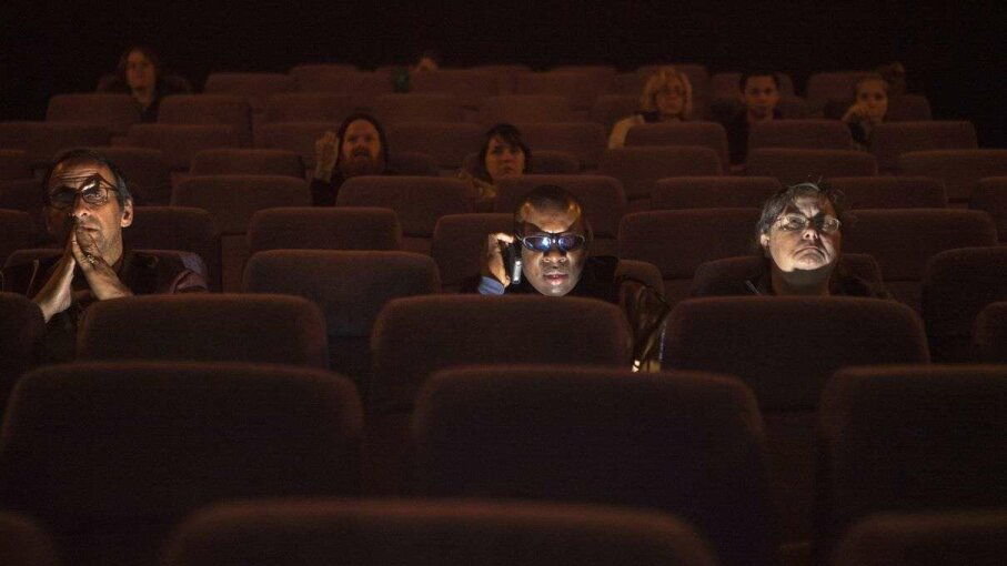 """GAIA SQUARCI/Reuters/Corbis Students from the World Services for the Blind (WSB) sit to enjoy the movie """"Cloud Atlas"""" inside a Little Rock, Arkansas, theater in 2013."""