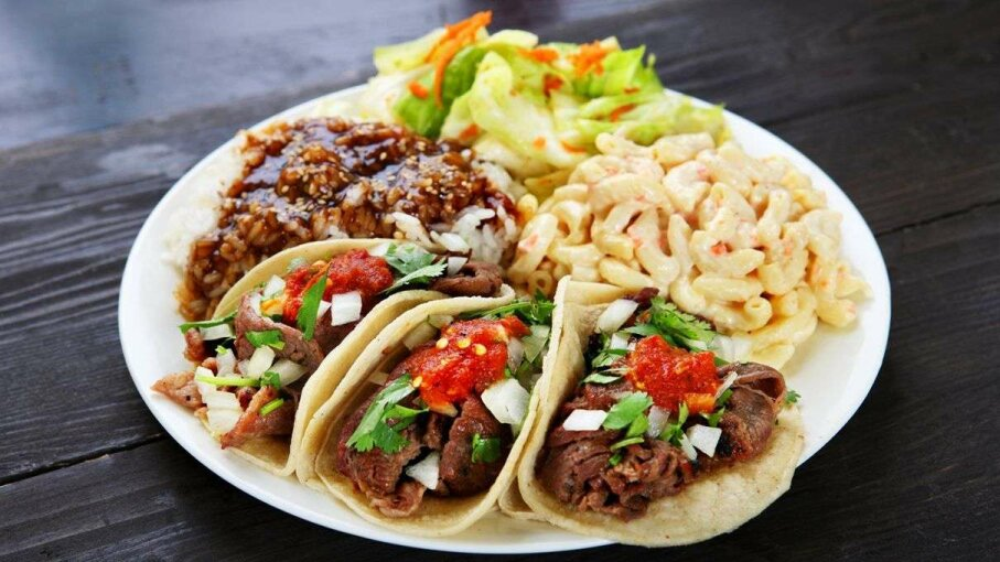 Tacos? Check. Macaroni salad? Check. Curry? Check. Cohesive meal? Eh, not so much. whitewish/Getty Images