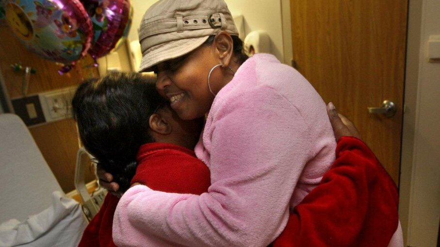 Edwina Jones (right) embraces her kidney donor LeQuenes Smith as they both recover from the kidney transplant surgery at Methodist Hospital. Smith donated a kidney to Jones.  Nikki Boertman/ZUMA Press/Corbis